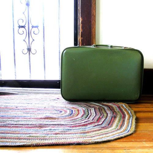 Crochet Rug and Green Vintage Suitcase