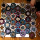 Hexagon wool crochet rug in progress by anneemcgraw
