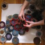 Hexagon wool crochet rug in progress by anneemcgraw